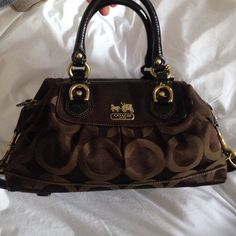 Chocolate brown coach bag Beautiful bag in Good condition. Small tear 1cm tear on corner. Make an offer!! Coach Bags Shoulder Bags