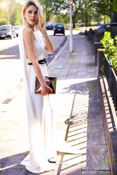 Blogger, Sofie Valkiers in a ELIE SAAB Resort 2014 white jumpsuit during Sao Paulo Fashion Week.