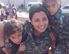 Didn't take this photo (Daily Mail), but it affects me greatly. A mother and her two children...it's heart wrenching. Kurdish mother-of-two launches suicide attack to slow Islamic State advance in desperate battle for Kobane