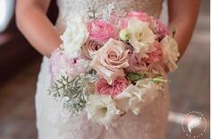 There's just something about this bouquet against that dress that leaves us mesmerized. The fact that it was Captured By Elle Photo + Video behind the camera just makes it even better! (Location – The Ballroom at Church Street )