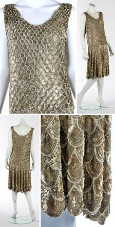 Evening dress ca. 1927. Tulle ground applied with embossed golden sequined scales edged in pearl beads, which increase in size from neck to hem. Kerry Taylor Auctions