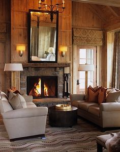 Rustic meets modern living room. Neutral colours, wood and stone elements, statement fireplace.