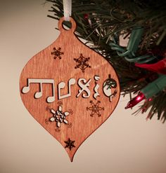 Music Symbol Christmas Ornament that spells music with by 5thP, $4.25