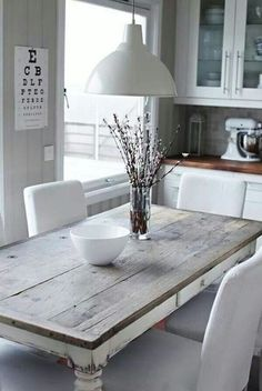 Another beautiful weathered wood table. Fresh, modern, country chic. Want the look - use Driftwood Weathering Wood Finish on top and Poet's Paint Waterglass Paint in Vintage White on bottom.