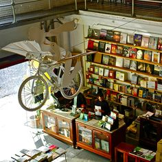 Ler Devagar (Slow reading) bookshop, Lisbon Factory, Alcantara, Lisbon, Portugal love the bike! Beautiful French Words, Most Beautiful, Book Cafe, Book Storage, Shop Around, Portugal Travel, Book Worms, Bookshelves, The Good Place