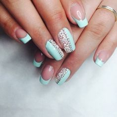 Classic-cut french in light blue color looks beautiful and elegant. French smile on the tips of the nails are replaced by sophisticated pattern on the ligh