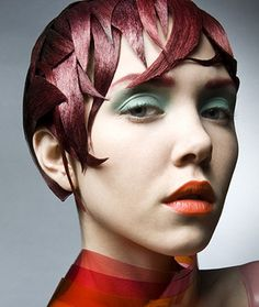 A short red straight quirky avant garde sculptured hairstyle by Anne Veck Hair