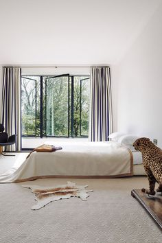 "[i]On the first floor is the main bedroom, with a taxidermy jaguar, an armchair by Pierre Paulin and single-pane windows that make the most of the garden views [/i]  Like this? Then you'll love  [link url=""http://www.houseandgarden.co.uk/interiors/bedroom""]Bedroom Ideas[/link]"