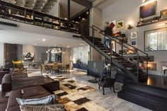 modern loft decor ideas open plan living room black staircase leather furniture modern lighting