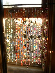 Dishfunctional Designs: Small mirrors make an interesting addition to this colorful bead curtain