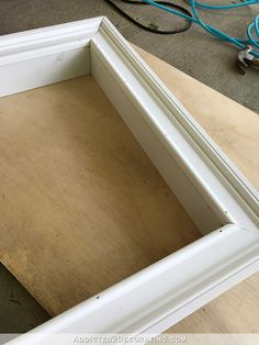 how to build an easy DIY frame for a wall mounted flat screen tv - 4 - glue and nail the frame to the box