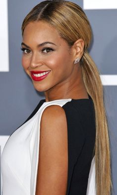 Beyonce is another star we couldnt imagine with short hair. She looks sleek with this low slung straight pony tail.