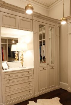 Custom cabinetry transforms a closet space into an elegant room , from Iryna