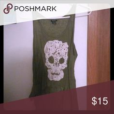 A Lace-Skull Tank Top This is a sheer green tank with a laced skull on the front. Rue 21 Tops Tank Tops