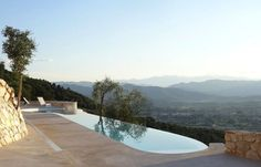 #minimal and #modern poolside exterior that focuses on the #natural views surrounding it