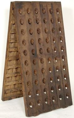 A Champagne Riddling Rack from France, originally used in the Champagne Region for the sparkling wine, a Riddler would go through once a day and turn the marked bottle a 4th of a turn every day to keep the yeast in the sparkly wine working.