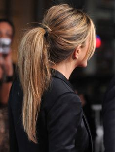 Ponytails that are anything but boring.. Jen Aniston's wrapped pony. Great color..