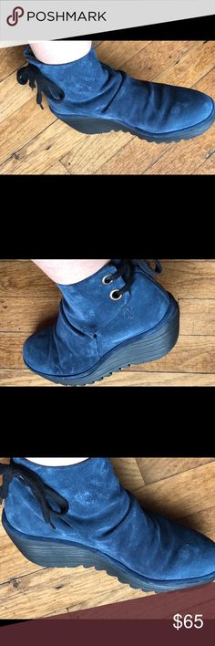Fly London Yama blue suede This is a beautiful pair of Yama Fly London ankle boots in blue suede. They have the customary FL black wedge hill. These tie with a black string making these suitable to wear with black or blue. They are beautiful boots.  They are a beautiful dark blue what I would describe as navy. These have only been worn a couple of times. Great shape at a fraction of the cost. Fly London Shoes Heeled Boots