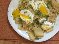 This buttery tangle of torn lasagna noodles gets amped up with a touch of umami-rich soy sauce, brightened with fresh lemon juice, enriched with grated cheese, and made into a complete meal with the addition of a few runny poached eggs.