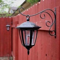 Hang dollar store solar lights on basket hooks. | 41 Cheap And Easy Backyard DIYs You Must Do This Summer #LandscapingIdeas