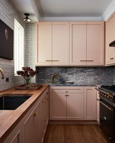 This kitchen designed by might be my absolute favorite 💗 When I think pink cabinets, I think atomic.this is sophisticated, elegant, and elevated. Could you do a pink kitchen? Home Decor Kitchen, Kitchen Interior, New Kitchen, Home Kitchens, Awesome Kitchen, Dark Kitchens, Kitchen Ideas, Peach Kitchen, Tiny Kitchens
