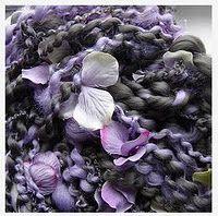 Beautiful purple yarn with flowers.
