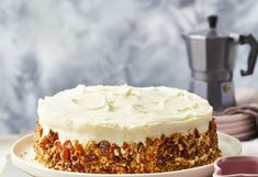 Carrot cake is made even better with walnut praline and, of course, dollops of deliciously creamy cream cheese.