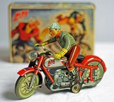 Nice Arnold Mac 700 Motorcycle w/box. German wind up tin toy from 40s. Ebay.