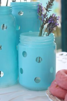 Just take old jars, put round stickers where you don't want the paint and spray paint them.  After paint dries, peel off stickers with tweezers. Probably could use these for candles too