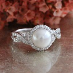Halo Diamond Pearl Engagement Ring in 10k White Gold Infinity Diamond Band June Birthstone Ring, Round Cut Ring, Size 7 (Resizable) by LuxCrown on Etsy https://www.etsy.com/listing/272969214/halo-diamond-pearl-engagement-ring-in