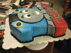 Thomas the Train Cake: This is the train I made for a co-worker's son's birthday. For the face I used rolled fondant. I used small balls of fondant under his nose and cheeks. Thomas Birthday Parties, Thomas The Train Birthday Party, Trains Birthday Party, Train Party, Cool Birthday Cakes, 4th Birthday, Birthday Ideas, Pirate Party, Thomas Birthday Cakes