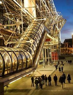 The Centre Georges Pompidou - Paris Could be a fun idea that you have a clear acrylic tube with paint splattered or something for capstone.