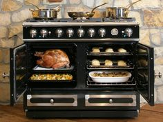 In my dreams - La Cornue CornuFé Range: 2 electric convection ovens & 5 gas burners. I love the huge burner in the middle!