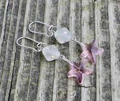 Starfish Pink Swarovski Glass Earrings $12.00 These beautiful earrings remind me of how much I wish I was on the beach.  They are made with pink glass starfish charms and frosted glass beads with Swarovski Elements aurora borealis rhinestones on silver plated kidney wires.