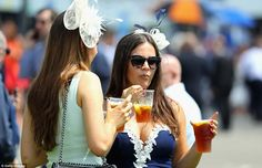 Bottom's up! It was certainly thirsty work for the ladies in Surrey today as they downed Pimm's in the summer heat