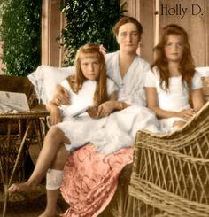 Tsarina Alexandra with Marie and Anastasia..is that a bandage around Anastasia's leg?