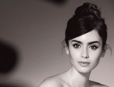 Lily Collins. This updo is so pretty! And I love the makeup.