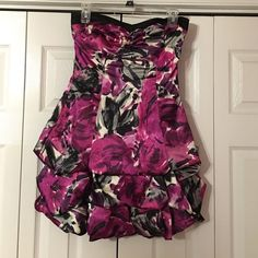 Strapless dress Form fitting at the top, loose at the bottom, pink, purple, sliver, and black pattern, strapless, short, only wore once Dresses Strapless