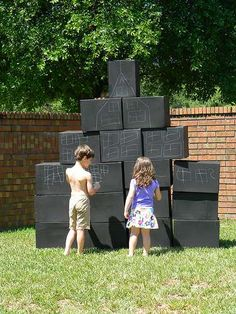 Cardboard boxes painted with chalkboard paint | CatchMyParty.com