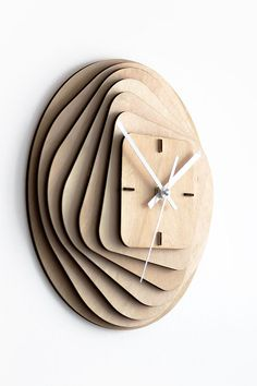 The clock consists of 11 laser cut 3mm birch plywood parts with 7 main layers with 3mm space between them and 4 construction parts that are also cleverly used as a main hour dial.The layers are forming transformation from outer circular shape to inner s…