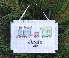 This Babys First Christmas Pastel Train Stocking Ornament will be a keepsake for every Xmas to come. It is hand embroidered with cross stitch and is personalized with the babys name and the year. The ornament measures 2 1/2 X 3 1/2 and has a ribbon at the top for easy hanging. This Babys 1st Christmas ornament is a unique newborn gift that can be given at any time of the year and makes a wonderful Grandparents gift too! Please convo me with the babys name with your order.  I really ...
