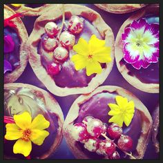tarts with pear caramel filling, chocolate ganache topping, berries & autumnal edible flowers