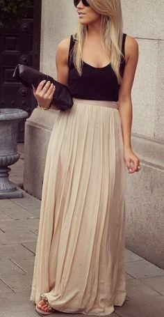 black top + nude pleated skirt .