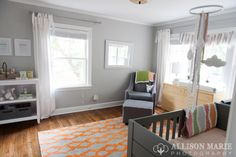 Cute neutral twin nursery - put chair in the corner, changing table by the window and side by side long ways on the wall.