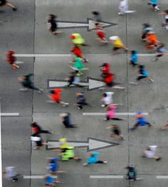Runners make their way after the start of the Vienna city marathon, in Vienna, Austria.  [But they're going the wrong way!]