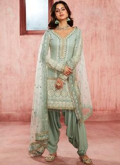Dusty Blue Embroidered Georgette Punjabi Suit features a georgette kameez embellished with thread, zari and stone work alongside a net dupatta and santoon bottom. Like all our pieces, this style is made in India and checked by hand to ensure high quality. Latest Punjabi Suits Design, Designer Punjabi Suits, Designer Sarees, Punjabi Salwar Suits, Punjabi Dress, Patiala Dress, Salwar Suit Pattern, Indian Suits Online, Patiala Suit Designs