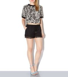 Mix chic detail and sports luxe with these lace hem running shorts. Pair with a graphic t-shirt and light blue heels for a glamorous evening alternative.