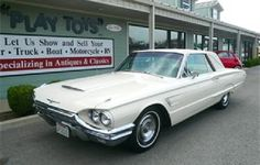1965 Ford Thunderbird, White with Beige & Brown Interior.