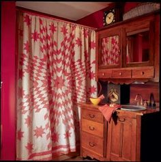 A quilt becomes a shower curtain in a bath with a cabinet adapted from an antique cupboard. Photo: Jessie Walker