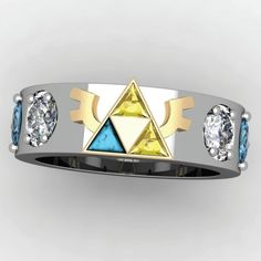 Words cannot properly express how much I want something like this. Not even marriage related. I just want it. >_> Engagement rings and wedding bands are modeled after the sacred Triforce relic from the Legend of Zelda.